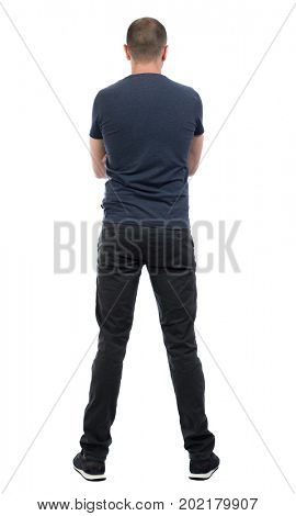 Back view man in trousers. Standing young guy. Rear view people collection.  backside view of person.  Isolated over white background. guy in black trousers stands with his arms crossed over his chest