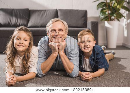 Smiling Family Lying On Floor