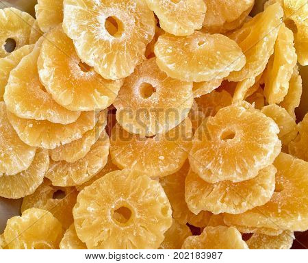 dry pineapple close up, many pineapple slices stacked ,dried fruit pineapple