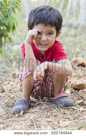 Portrait of happy Asian little boy smile outdoor
