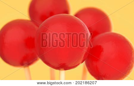 Retro styled red balls of lollipops on a stick. Macro shot with shallow DOF. Horizontal wide pop art style poster with close up round candies