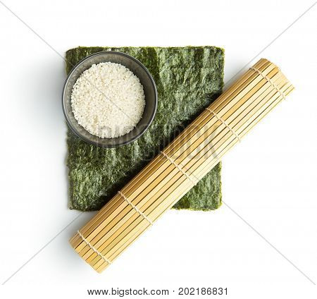 Green nori sheet , rice and bamboo mat isolated on white background. Sushi ingredients.