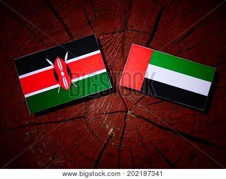 Kenyan Flag With United Arab Emirates Flag On A Tree Stump Isolated