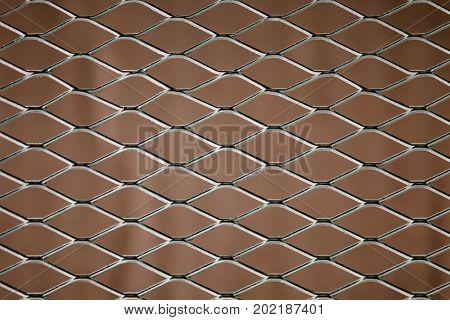 Old mesh in blurring. Colorful pattern. Steel rhombus.