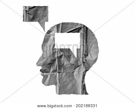 Crumpled paper shaped as a human head and talk balloon on white background. Speak and opinion concept.
