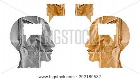 Crumpled paper shaped as a human heads and talk balloons on white background. Conversation dialogue and opinion concept. Two heads.