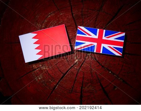 Bahraini Flag With British Flag On A Tree Stump Isolated