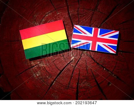 Bolivian Flag With British Flag On A Tree Stump Isolated