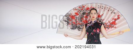 Digital composite of Geisha with giant fan against white background
