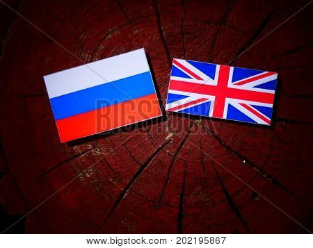Russian Flag With British Flag On A Tree Stump Isolated