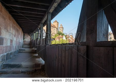 The Castle Of Nuremberg In The Afternoon Sun From The Guards Walkway With A Wooden Roof