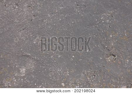 Weathered Dusty Uneven Dark Grey Concrete Slab