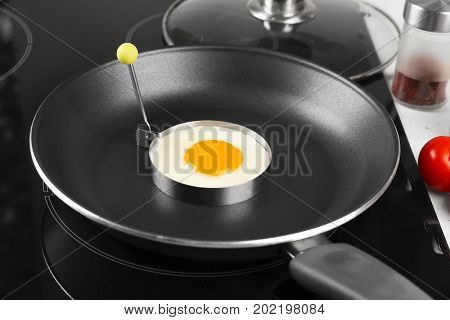 Cooking of delicious sunny side up egg, closeup