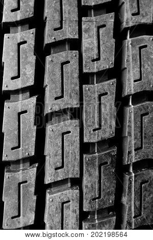 automobile tire close up with the tire-tread drawing.