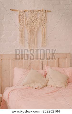 Bed in a vintage style with pillows on it