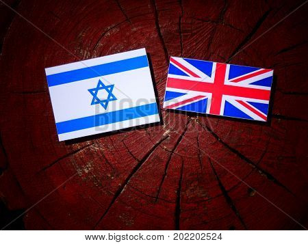 Israeli Flag With British Flag On A Tree Stump Isolated