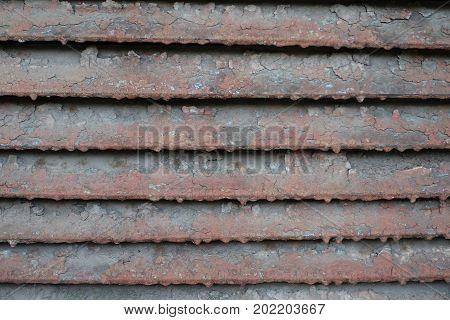 Weathered Painted Louver Of Angled Metallic Slats