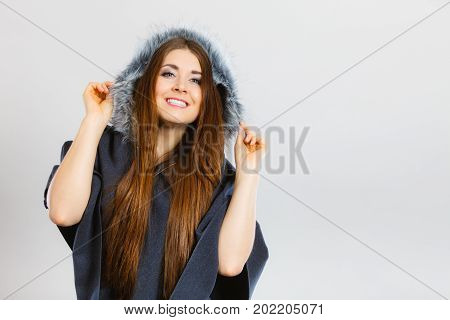 Happy Woman Wearing Dark Poncho With Hood