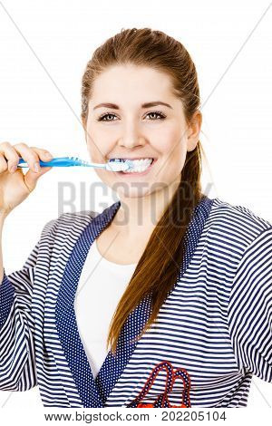 Woman wearing dressing gown brushing cleaning teeth. Smiling positive girl with toothbrush. Oral hygiene. Isolated on white