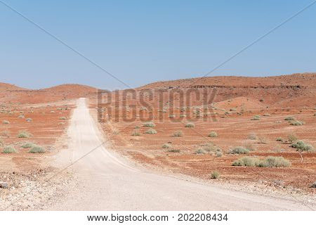The orange-red rocky Namib desert landscape at Dopsteekhoogte Pass on the C39-road to Torra Bay in the Kunene Region of Namibia
