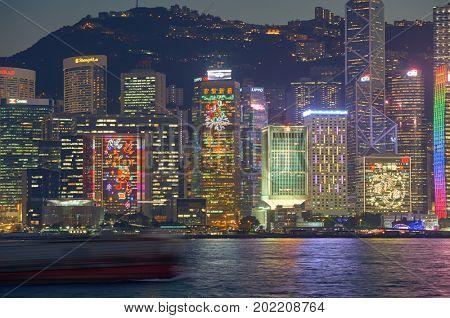 HONG KONG - JANUARY 25, 2016: dusk view of Hong Kong Island as seen from Tsim Sha Tsui. Hong Kong Island is an island in the southern part of the Hong Kong Special Administrative Region.