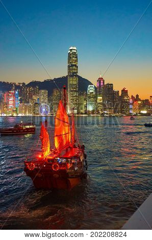 HONG KONG - JANUARY 25, 2016: view of Victoria Harbour from Tsim Sha Tsui. Victoria Harbour is a natural landform harbour situated between Hong Kong Island and Kowloon in Hong Kong