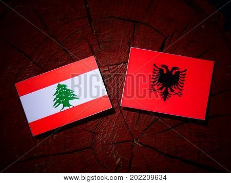 Lebanese Flag With Albanian Flag On A Tree Stump Isolated