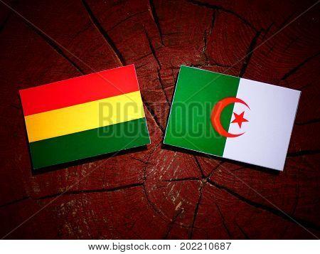 Bolivian Flag With Algerian Flag On A Tree Stump Isolated