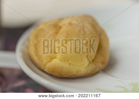 Cream puff or Choux pastry cream puffs on white plate