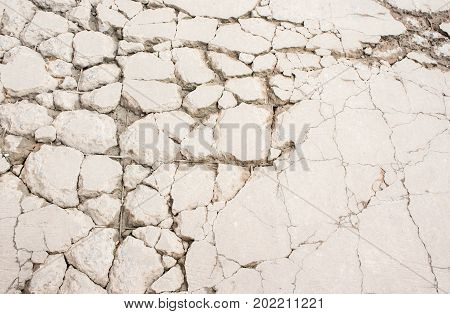 Cracking of concrete cement floor. construction surface crack of concrete floor