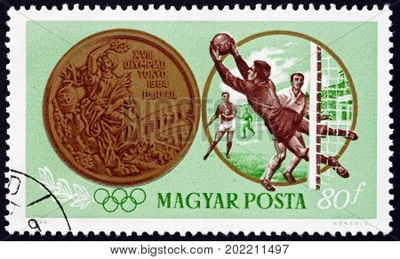 HUNGARY - CIRCA 1965: a stamp printed in Hungary shows Soccer Olympic Medal Victory by the Hungarian Team in the 1964 Olympic Games Tokyo circa 1965