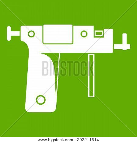 Piercing gun icon white isolated on green background. Vector illustration