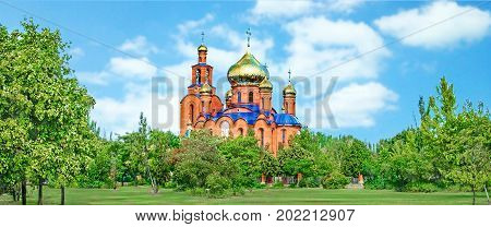 The Church of THE HOLY APOSTLES AND THE GOSPEL JOHN OF BOGHOSLOV in Pokrov city in Ukraire. Panorama of the holy Christian temple in the park in summer