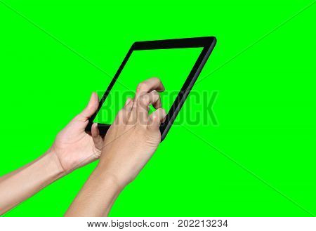 Business woman using a tablet computer on green screen