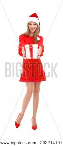 Beautiful young woman in Santa hat holding giftbox, on white background