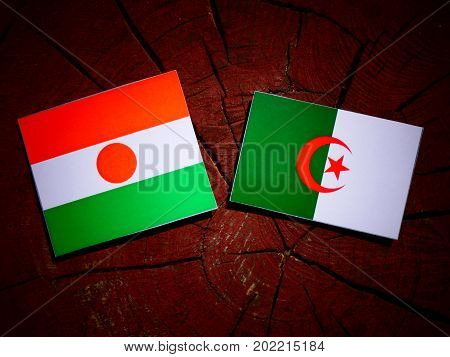 Niger Flag With Algerian Flag On A Tree Stump Isolated