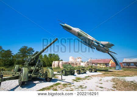 Karlovac, Croatia, August 27, 2017: Old cannon and Russian fighter jet in military open air museum in Turanj, Karlovac, Croatia