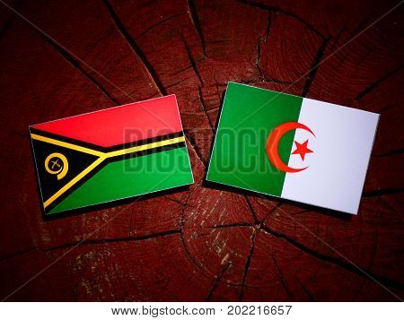 Vanuatu Flag With Algerian Flag On A Tree Stump Isolated