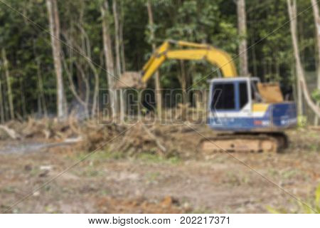 Defocused blur of crawler dozer working in the construction site for background
