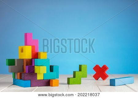 Colorful constructor logic game cubic mosaic. Design created by cubes. The concept of logical thinking geometric shapes.