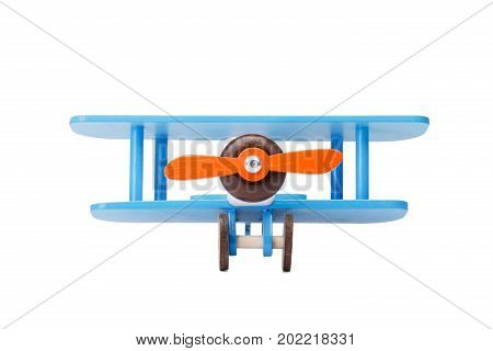 A close-up picture of a blue wooden toy airplane, isolated on a white background. A miniature toy airplane for children games. A developing plaything a symbol of travel and dreams. Copy space.