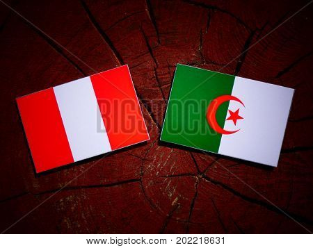 Peruvian Flag With Algerian Flag On A Tree Stump Isolated