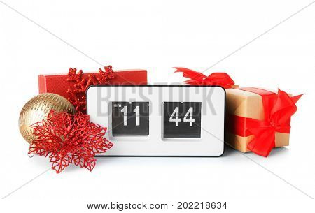 Digital alarm clock and decorations on white background. Christmas countdown concept