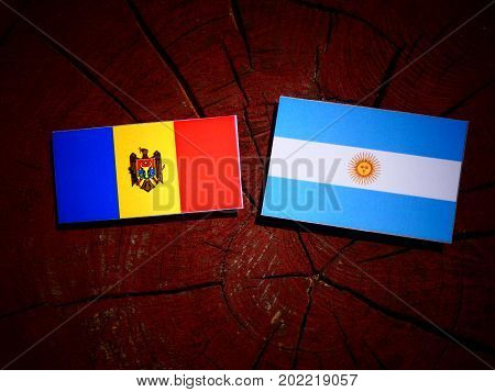 Moldovan Flag With Argentinian Flag On A Tree Stump Isolated