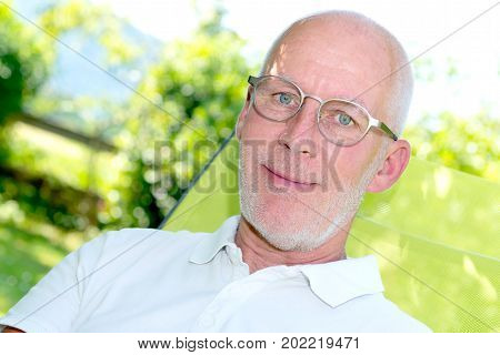 a portrait of handsome 55 years old man with eyeglasses