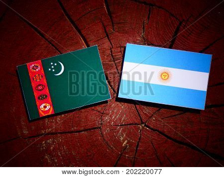 Turkmenistan Flag With Argentinian Flag On A Tree Stump Isolated