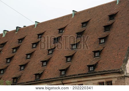 Strange Roof Of The House With Dormer Windows