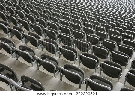 Reclining Chairs On The Stadium Bleachers With No People Before