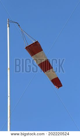 Red And White Windmill To Signal The Wind Direction