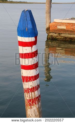 Pole Called Bricola In Italian Language To Moor The Boat